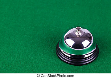 Silver alarm service bell on green background
