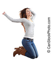 Pretty teen jumping happy with her arms raised on a white...