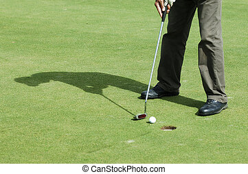 Final putt on golf course - Final putt on golf green course