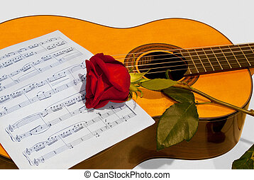 A guitar and a rose - The composition of the guitar and...