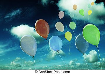 colored ballons against cloudy sky - Lots of colorful...