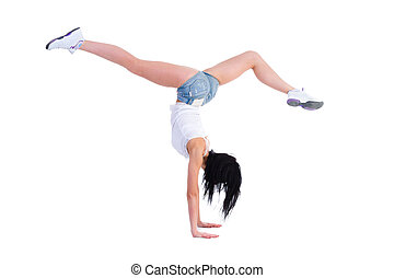 woman does a gymnastic handstand Isolated on white...