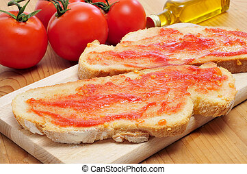 pa amb tomaquet, bread with tomato, typical of Catalonia,...