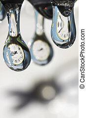 Drops of time. Play with water and clocks.