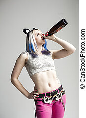 Beautiful Young Woman with Blue Hair Drinking a Bottle of...