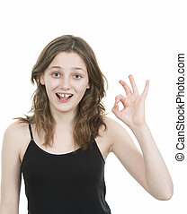 Pre teen young girl making an ok hand gesture