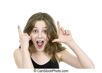 Pre teen young girl looking at camera making hand gestures