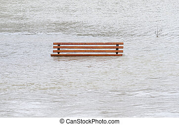 Flood - a park bench surrounded by water