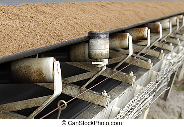 conveyor belt covered with sand