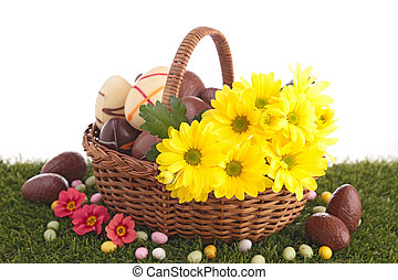 easter eggs in wicker basket with flowers