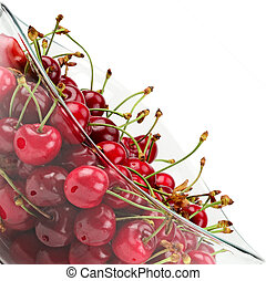 fruits of cherries in a glass bowl