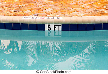 Five feet marking on swimming pool depth - Sign showing 5 ft...