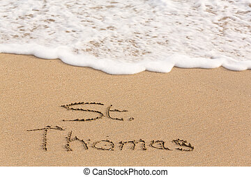 St Thomas written in sand with sea surf - St Thomas words...