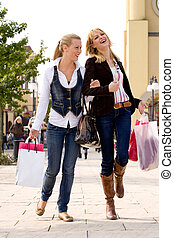 Finished with shopping - Two young girls shopping in the...