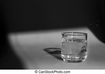 alka seltzer dropped into a glass of water - Anti Acid...