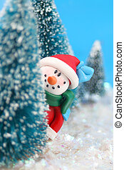 hiding Snowman - winter scene in glitter, a snowman is...