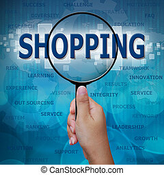 SHOPPING in Magnifying glass on blue background