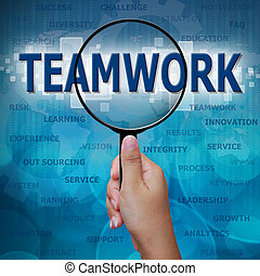 TEAMWORK in Magnifying glass on blue background