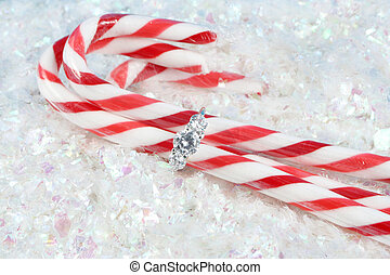 christmas engagement - diamond engagement ring holding candy...