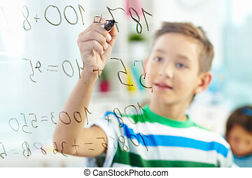 Mathematics - Cute learner doing sums with schoolmate on...