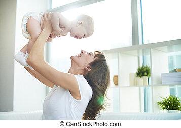 Joy - Portrait of joyful mother and son having fun