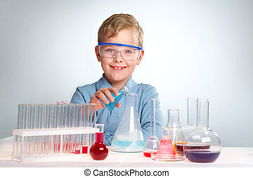 Experiment - An enthusiastic boy looking at camera during...