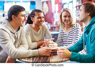 Friends in cafe - Image of teenage friends spending time in...