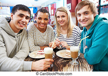 Gathered in cafe - Image of teenage friends spending time in...