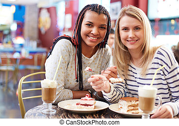 Girlfriends in cafe - Image of two teenage girls spending...