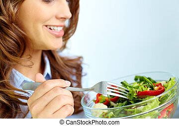 Eating salad - Close-up of pretty girl eating fresh...
