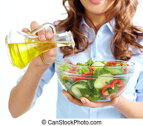 Appetizer - Close-up of female pouring oil into vegetable...