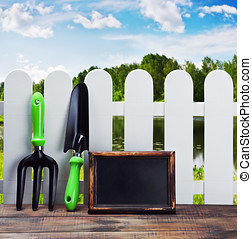 garden tools and equipment and a white fence