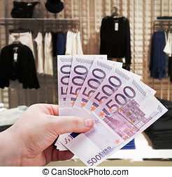 hand holding euro to new shopping in the supermarket