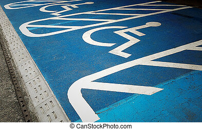 handicap icon on the road - Row of empty disabled parking...