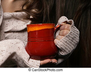 hands holding mug of hot drink, closeup - Closeup female...