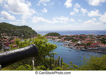 Old cannon in Gustavia Harbor - Old cannon on top of...