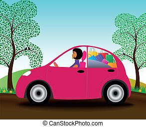 Beautiful girl girl in a pink car