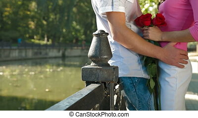 Couple in Love - romantic couple with a bouquet of roses in...