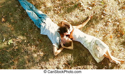 Hot summer - couple lying - Happy couple lying under a tree...