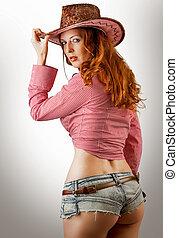 mujer, Llevando, vaquero, sombrero