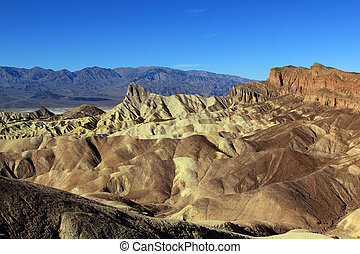 Zabriske Point - Rugged and barren terrain at Zabriske Point...