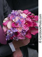 wedding bouquet for bride in hands of groom - beautiful...