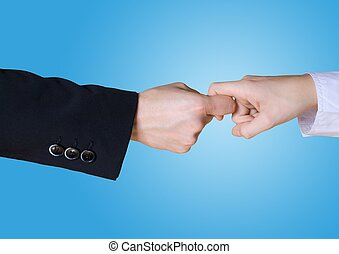 two business hands in rivalry, blue background - two...