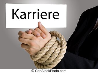 business hands in chains with banner Karriere - business...