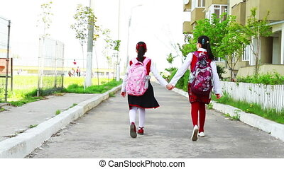 Little girls going to school - Little student girls with...
