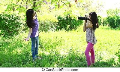 cute little girls making photos
