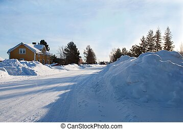 snow landscape - a street full of snow with some houses,...