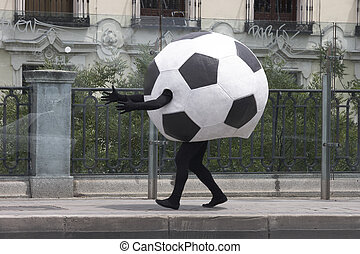 Soccer ball disguise on a street black and white