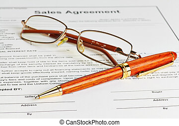 Contract with glasses and wooden pen ready to be signed