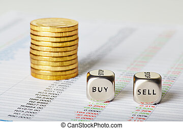 financial charts, golden coins and dice cubes with words Sell Buy. Selective focus